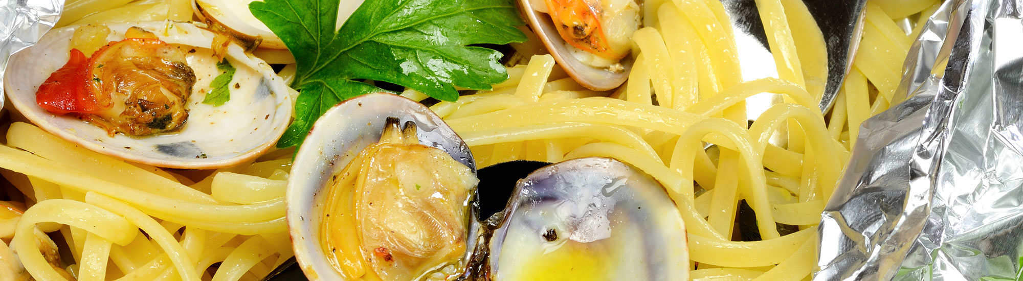 ricetta Tagliolini al cartoccio con cozze e vongole con pasta fresca